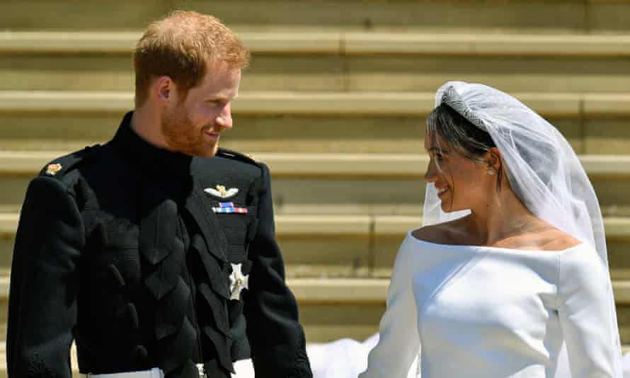 The start of married life: Prince Harry and Meghan Markle walk down the steps after their wedding at Windsor Castle in Windsor.