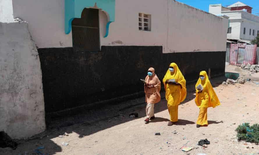 Students in Mogadishu wear face masks