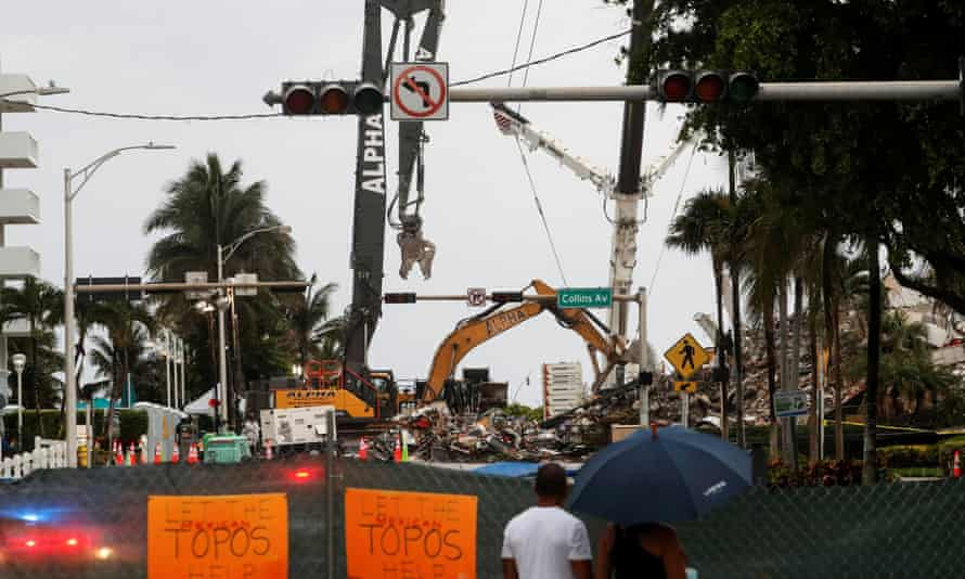 On Monday, lightning forced crews to pause the search for victims and a garage area in the rubble filled with water, officials said.