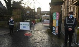 Security staff at the entrance of a Covid-19 vaccination centre set up at the Town Hall in Lancaster this morning.