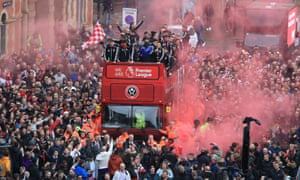 The Sheffield United players and the manager, Chris Wilder, wave to the fans during the promotion parade in Sheffield city centre