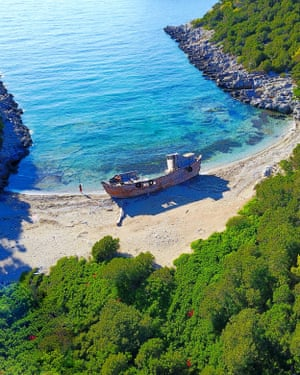 Drone image of Agalipa beach, Skyros. Skyros has dozens of beaches, including Agalipa, in the north of the island, with its wrecked wooden caique. The beach is only approachable by boat or on foot via a small path in the woods. According to locals, the boat, with 120 refugees on board, ran ashore in bad weather on a journey from Turkey to Kymi.