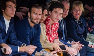 David, Victoria and Brooklyn Beckham front row at Jones's final show for Louis Vuitton in January.