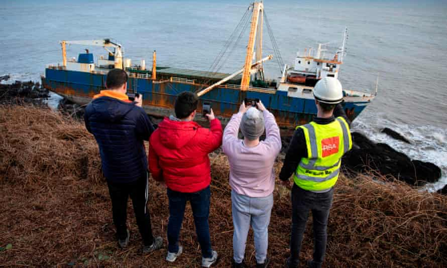 eople take photographs of the abandoned MV Alta