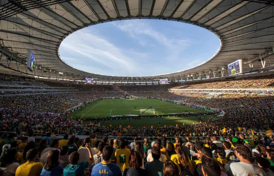 Fans watch a friendly soccer game between Brazil and England, at the Maracana stadium