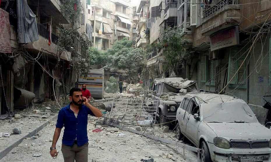 Residents in Aleppo inspect the damage from a rocket attack this week.
