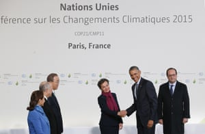 US president Barack Obama shakes hand with Christiana Figueres, as Ban Ki-moon, and the French delegation including President Francois Hollande, right, looks on, as they arrive for the COP21 talks in Le Bourget, Paris