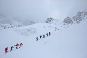 Tourists hike towards the Bogdanovich glacier in the Tian Shan mountain range