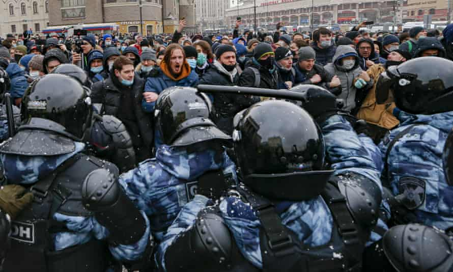People clash with police during a protest against the jailing of opposition leader Alexei Navalny in Moscow, Russia last week.