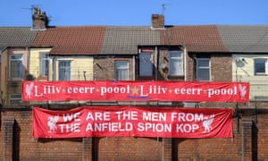 Peter Carney shows off two of his banners in Liverpool. Photo by Jack Finnigan.