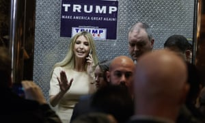 Ivanka Trump, daughter of President-elect Donald Trump, waves as she gets on an elevator at Trump Tower.