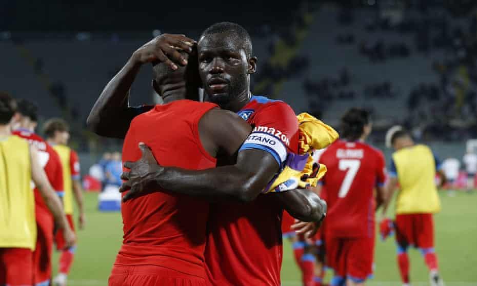 Kalidou Koulibaly celebrates Napoli's victory at Fiorentina with teammate Victor Osimhen.
