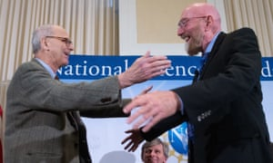 Ligio co-founder Rainer Weiss, left, and Kip Thorne, right, hug on stage during a news conference at the National Press Club in Washington.
