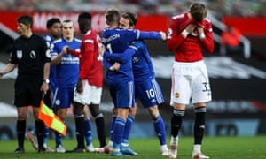 Leicester's Marc Albrighton and James Maddison of Leicester City celebrate at full time as United's Brandon Williams looks dejected.