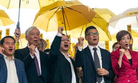 Hong Kong democracy activists Lee Wing-tat, Chu Yiu-ming, Benny Tai, Chan Kin-man and Tanya Chan hold a rally outside West Kowloon court on Monday.