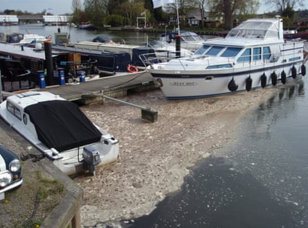 Sewage foam collects around boats at Bourne End Marina on the Thames path
