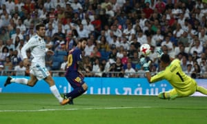 Lionel Messi's shot beats Navas but not the woodwork.