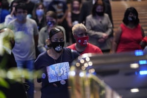 Mourners pass by the casket of George Floyd during a public visitation at the Fountain of Praise church.