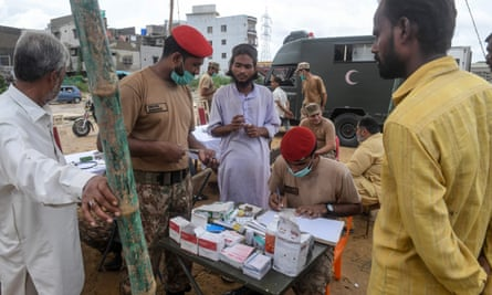 An Army medical team treats flood victims in the camp.