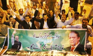 Supporters of Nawaz Sharif with a banner after the Pakistan supreme court's ruling.