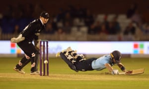 Heather Knight dives to reach her century.