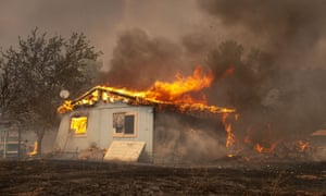 a house burns in a wildfire in lucerne california