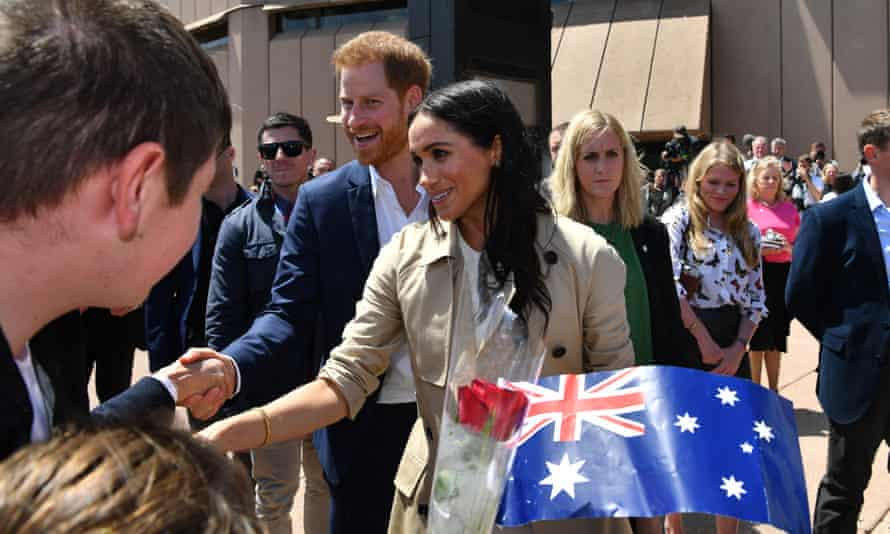 Thousands of fans lined up for a glimpse of the Prince Harry and Meghan outside the Sydney Opera House.
