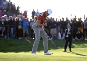 Europe's Henrik Stenson celebrates his putt on the 17th to win his match during the Foursomes.