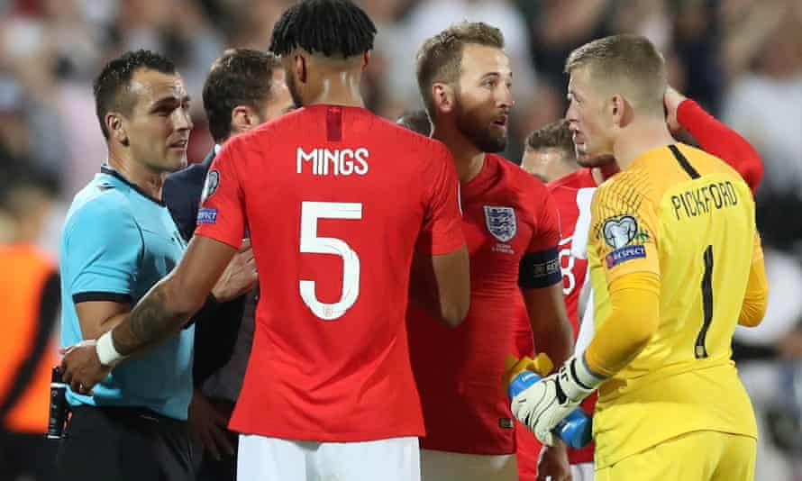 England players discuss whether to continue last week's game with the referee.