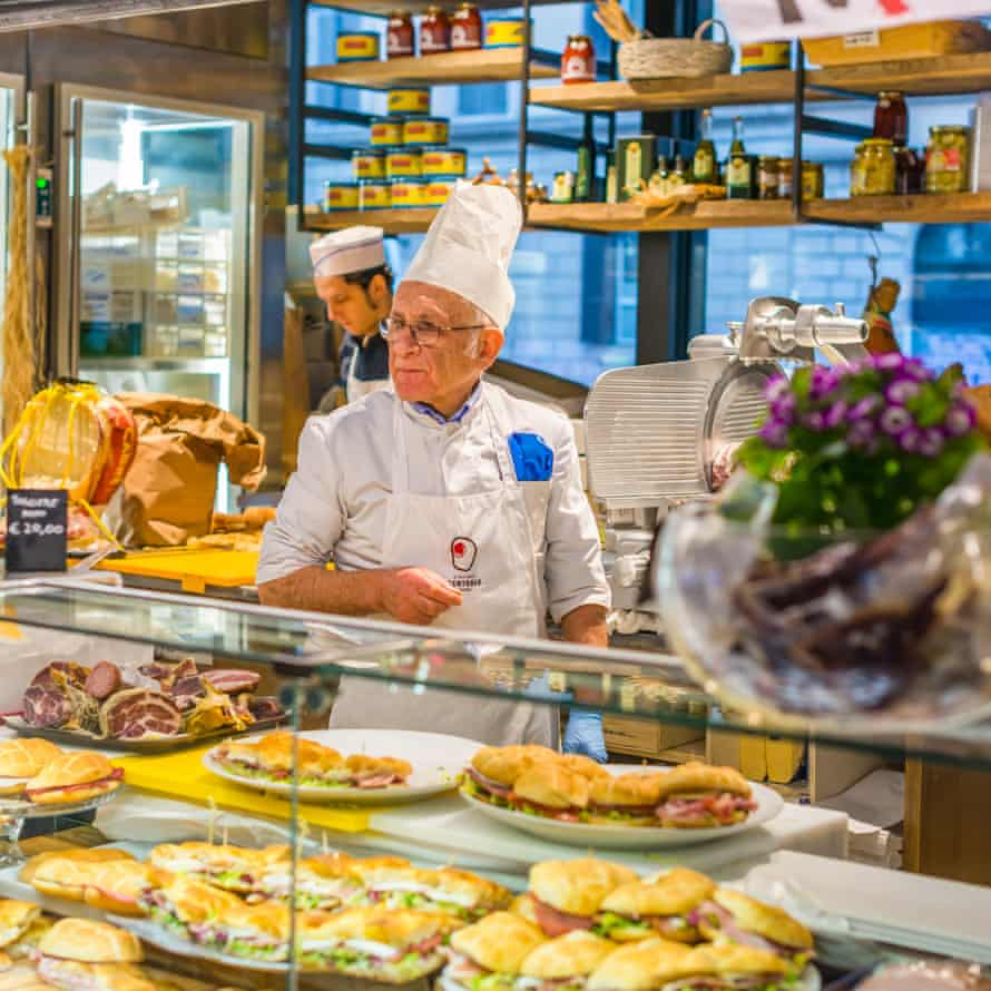 Two Italian men serving sandwiches at Mercato Centrale Roma next to Roma Termini railway station, Rome, Lazio, Italy.