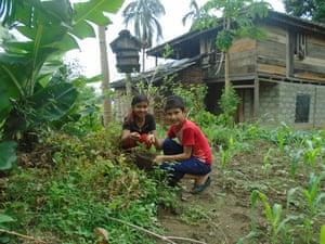 Debika and Ujjwol in a vegetable garden, Nepal