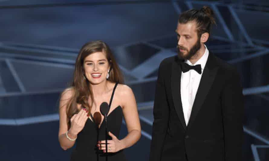 Rachel Shenton, left, and Chris Overton accept the award for best live action short for The Silent Child.