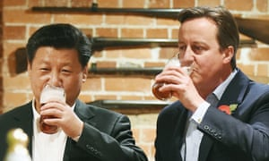 Former British prime minister David Cameron with Xi at a pub in Buckinghamshire during a state visit to Britain in 2015.