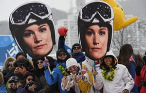 Supporters of Australia's Sami Kennedy-Sim hold up giant cut-outs of her prior to the women's ski cross events.