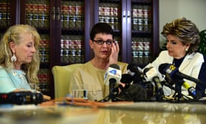 Beth Ferrier reacts while speaking seated between attorney Gloria Allred and Rebecca Lynn Neal, left.