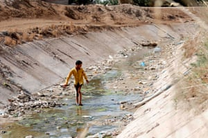 An Iraqi boy walks through a dried up irrigation dyke in the village of Sayyed Dakhil, 180 miles south of Baghdad.