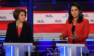 Congresswoman Tulsi Gabbard, right, speaks as Senator Amy Klobuchar looks on.