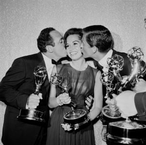Mary Tyler Moore is kissed by co-stars