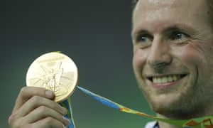 Jason Kenny shows off his gold medal for the keirin.