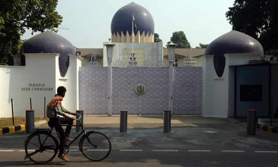 An Indian cyclist rides past the entrance to the Pakistan high commission in New Delhi.