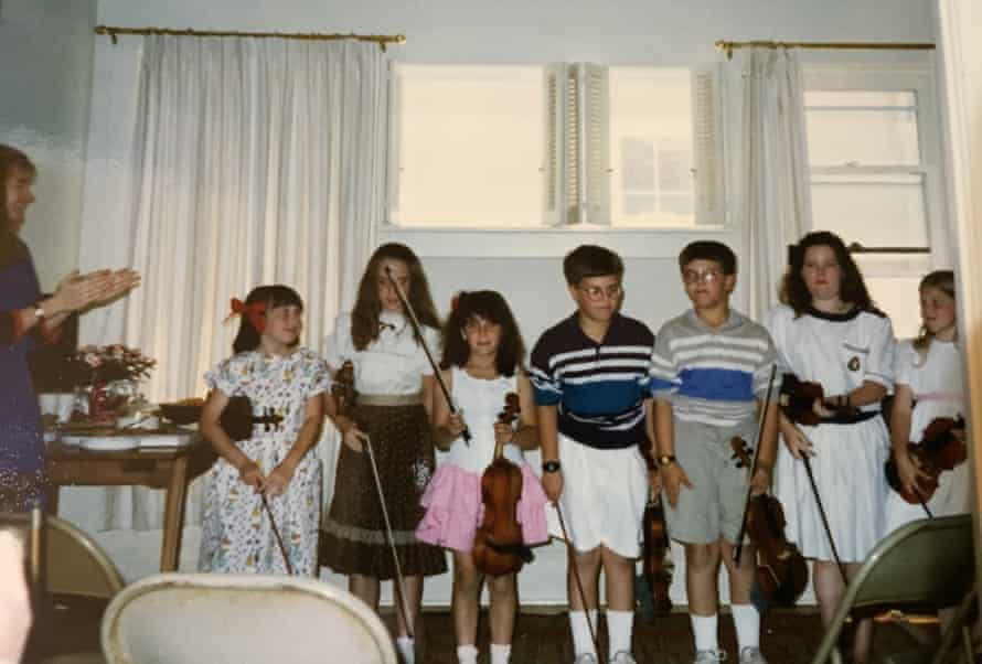 Jessica Chiccehitto Hindman as child, in the pink skirt.