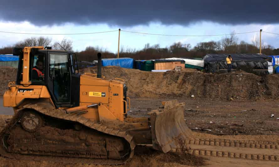 A bulldozer used to build a new road in the Calais camp