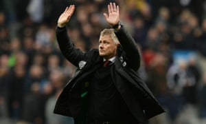 Ole Gunnar Solskjær holds his hands up apologetically to the Manchester United fans after defeat at Newcastle United.
