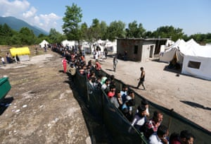 People wait for food and clothes at a migrant camp in Bihać, Bosnia-Herzegovina