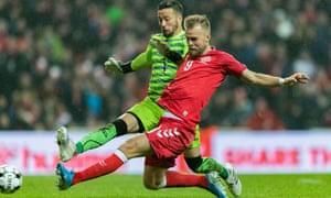 Christian Gytkjaer pounces on a defensive error to put Denmark 2-0 up.