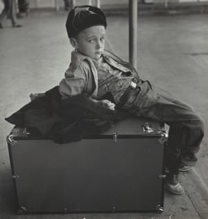Boy seated on trunk, Austin, Texas, 1950