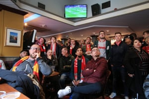 Liverpool fans watch title rivalries Manchester City against Crystal Palace in the pub before their game against Chelsea.