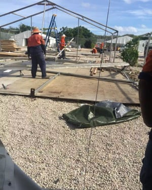 Workers seen dismantling the tents on Nauru, but the asylum seekers who were housed there are now in limbo.
