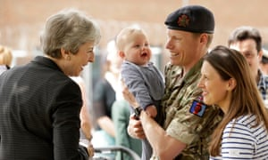 Theresa May meets military service personnel and their families at the headquarters of Joint Forces Command