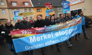 AfD supporters in Raguhn, Germany, march against Angela Merkel's refugee policy